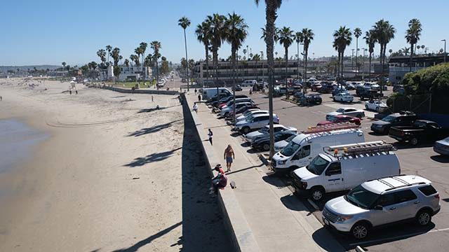 Beach parking lots open in line with city restrictions loosening. Ocean Beach Pier parking was nearly filled early in the morning.