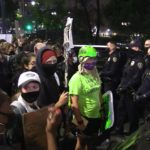 Protesters confront police