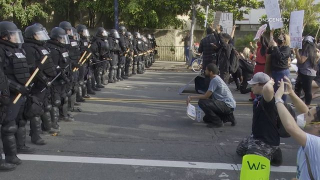 Protesters face police