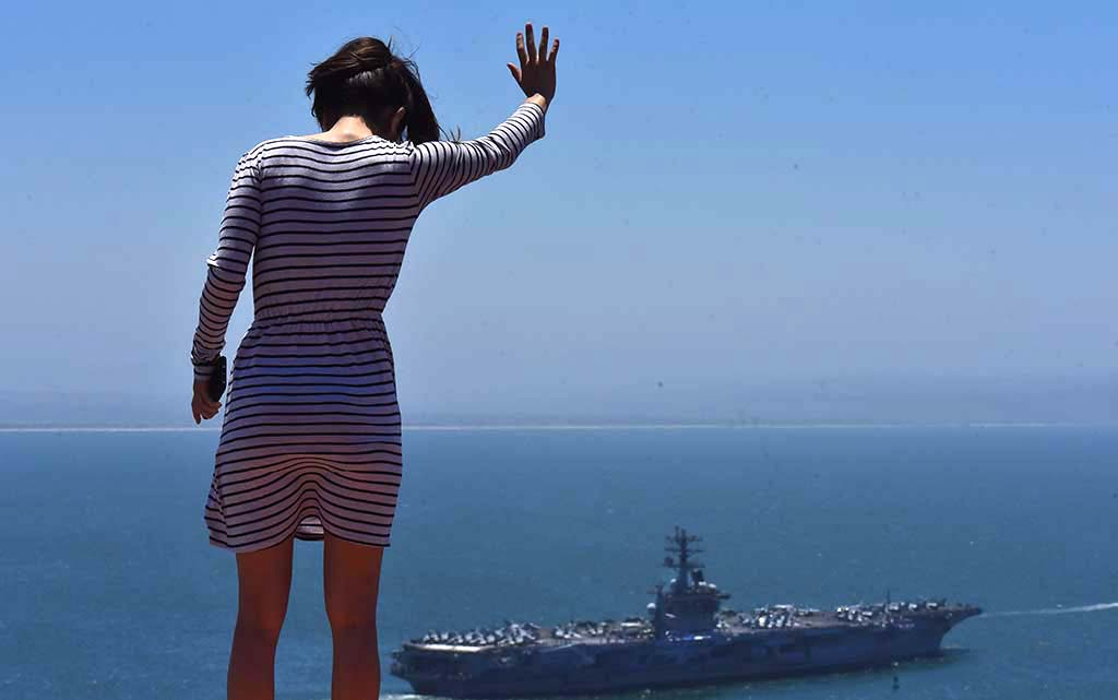 Navy Lt. Anise Crane, a doctor at the naval hospital, waves goodbye to a friend onboard the USS Nimitz.