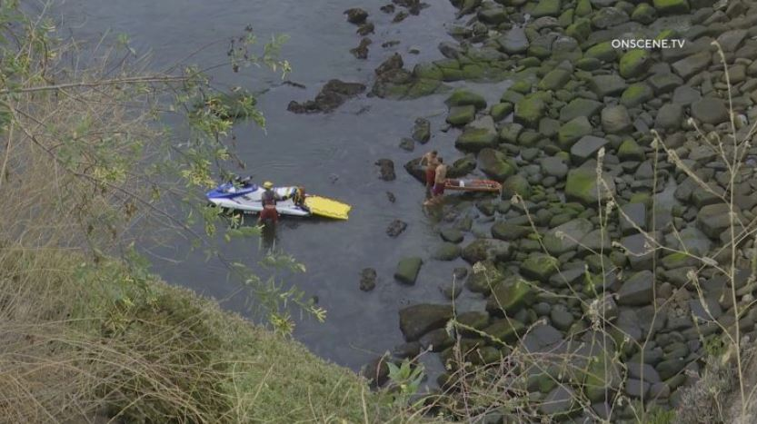 Lifeguards below the cliff where the woman fell