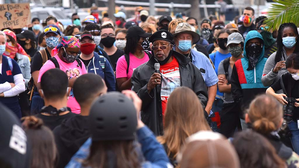 Henry Wallace, chairman of the San Diego Original Black Panther Party encourages protestors to continue to fight for justice.
