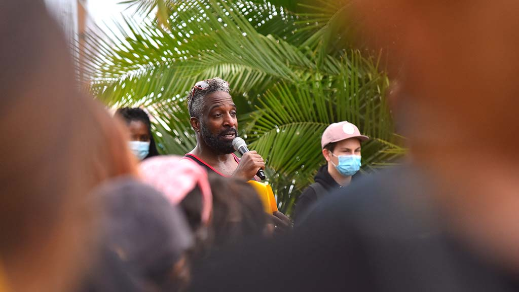Activist Charles Albert Brown speaks to protesters about the importance of voting in the upcoming election.