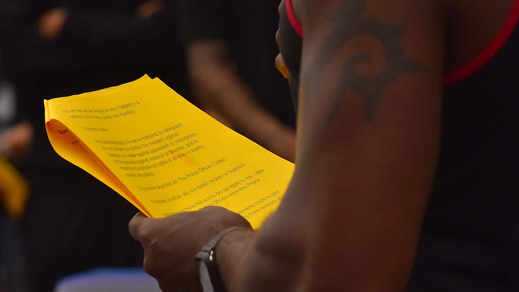 Activist Charles Albert Brown reads from prepared remarks at a Black Lives Matter protest and march that began at the San Diego County Administration building and ended at the Pride flag at Normal St. and University Avenue.
