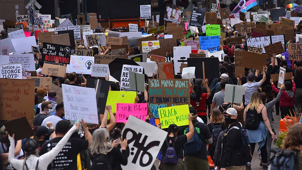 Thousands of protesters begin a Black Lives Matter march that began at the harbor and ended in Hillcrest.