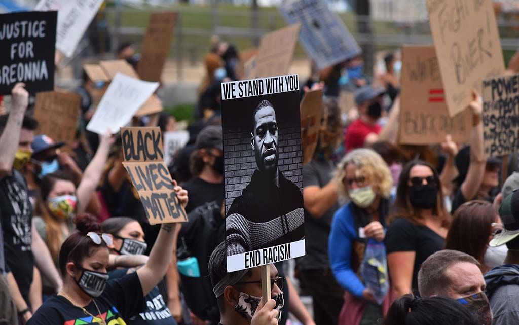 Marchers protest the death of George Floyd by a Minneapolis policeman on Memorial Day