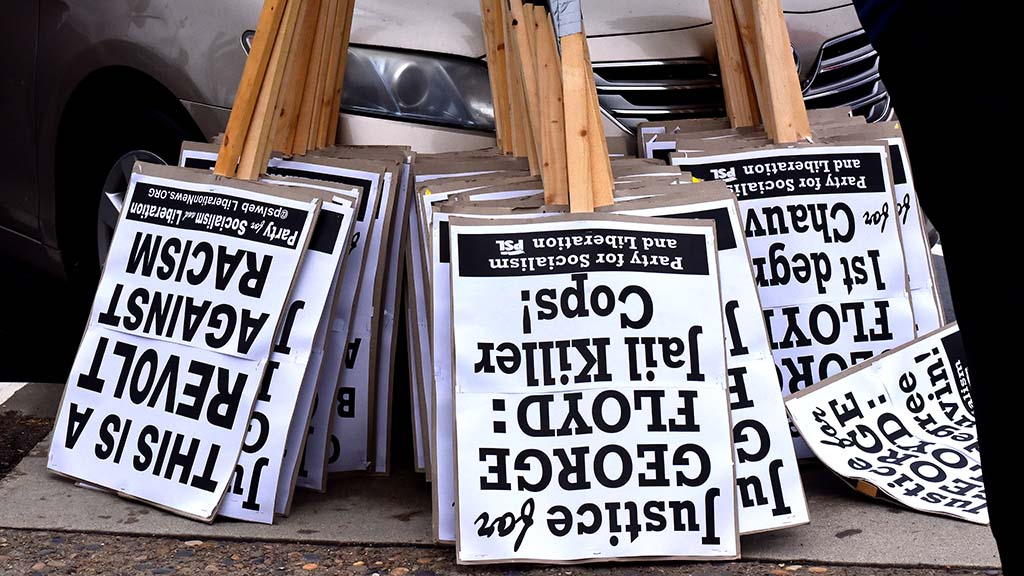 Signs are prepared for a Black Lives Matter march from the harbor to Hillcrest