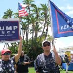 Many of the recall rally-goers sported flags and signs backing re-election of President Trump.