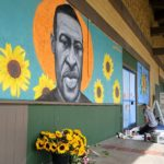 Artist Chloe Becky painted the image of George Floyd, the man killed in police custody in Minneapolis , near a beauty school.