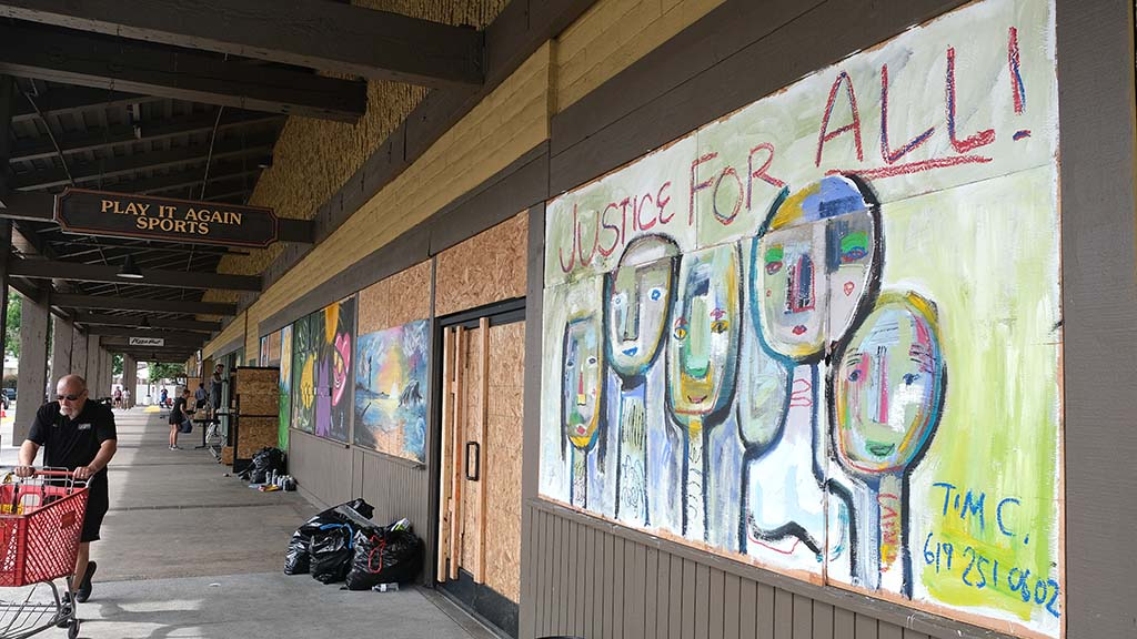 Fifteen local artists have donated their time and materials to paint murals at the La Mesa Springs Shopping Center after it was hit by looting and vandalism.