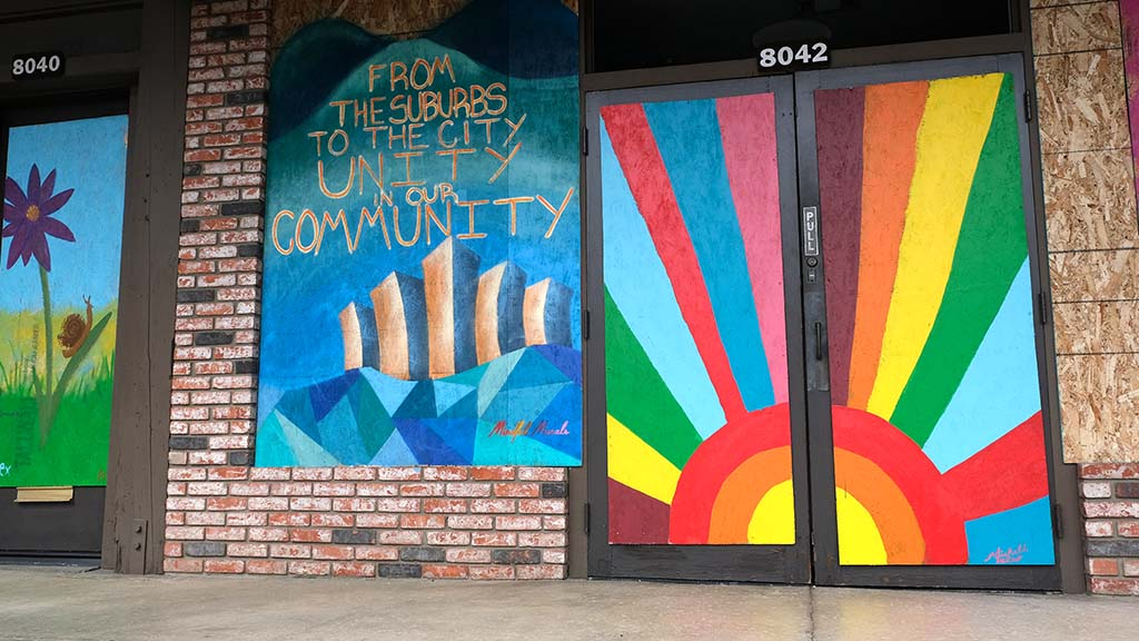 A window and doors of Crazy Fred's in the La Mesa Springs Shopping Center is full of color and has a message for the community.