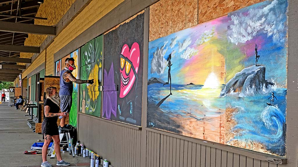Fifteen artists worked to beautify the La Mesa Springs Shopping Center after it was hit by looters on May 30.