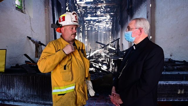 Archbishop José H. Gomez speaks with a firefighter