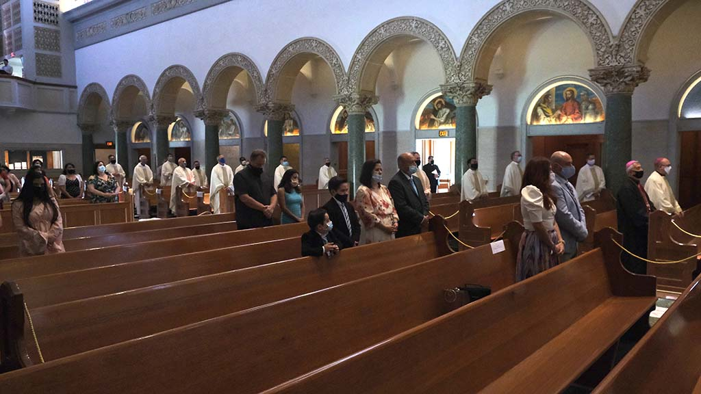 Family groups were distanced from others at an ordination ceremony in the Immaculata Church at USD.