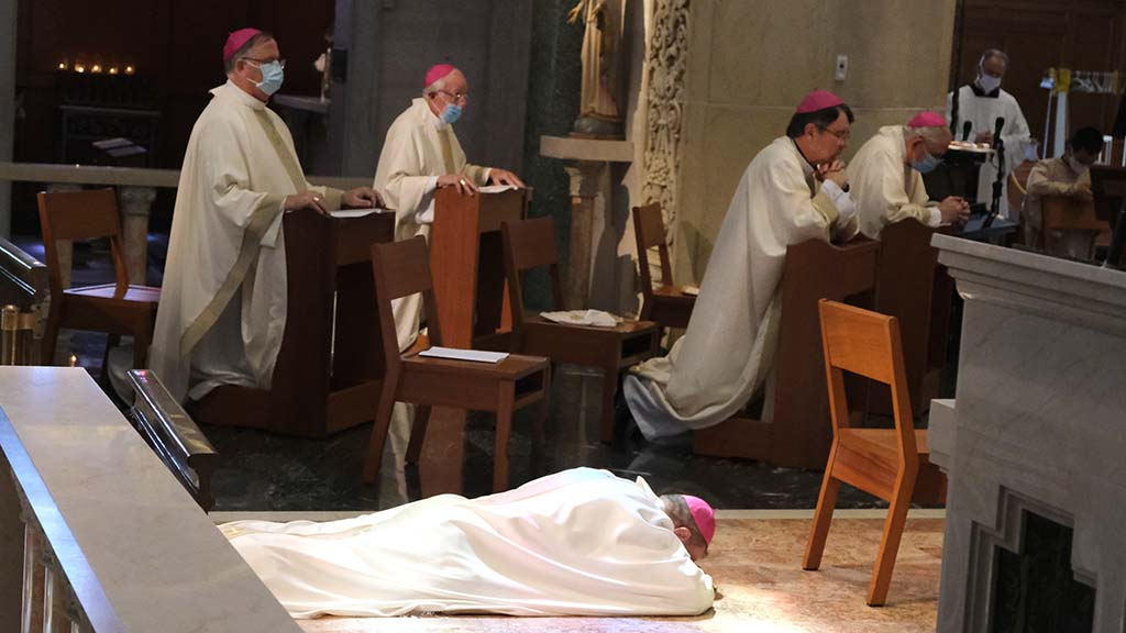 The Rev. Ramón Bejarano lies prostrate during prayers of intercession before becoming a new auxiliary bishop in San Diego.