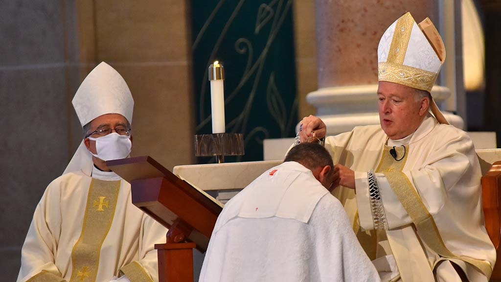 San Diego Bishop Robert McElroy anoints with oil Ramón Bejarano, who was ordained as a new auxiliary bishop in the diocese.