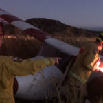 Cal Fire personnel examine plane