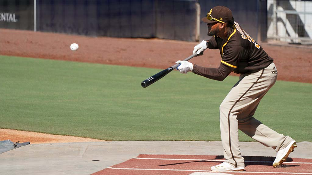 Outfielder Franchy Cordero practices bunting during summer camp at Petco Park.