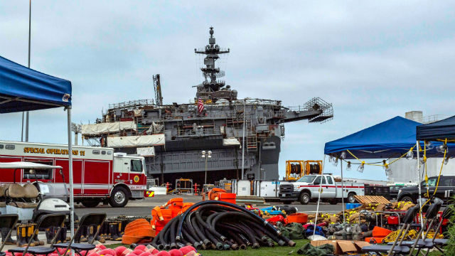 USS Bonhomme Richard lists at its pier on Friday morning