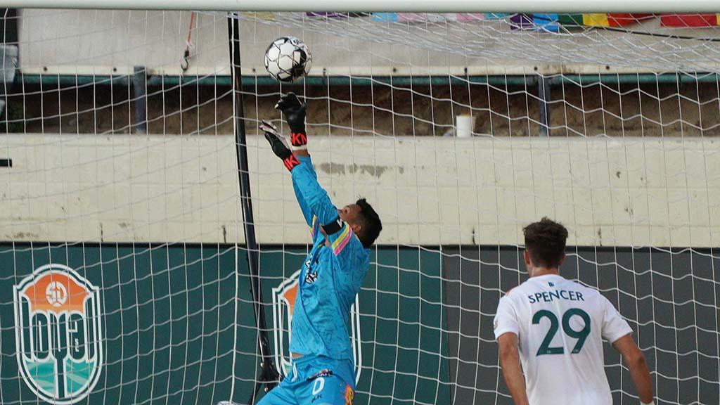 La Vegas Lights goalie Edward Delgado blocks one goal just before Tumi Moshobani hit in a goal.