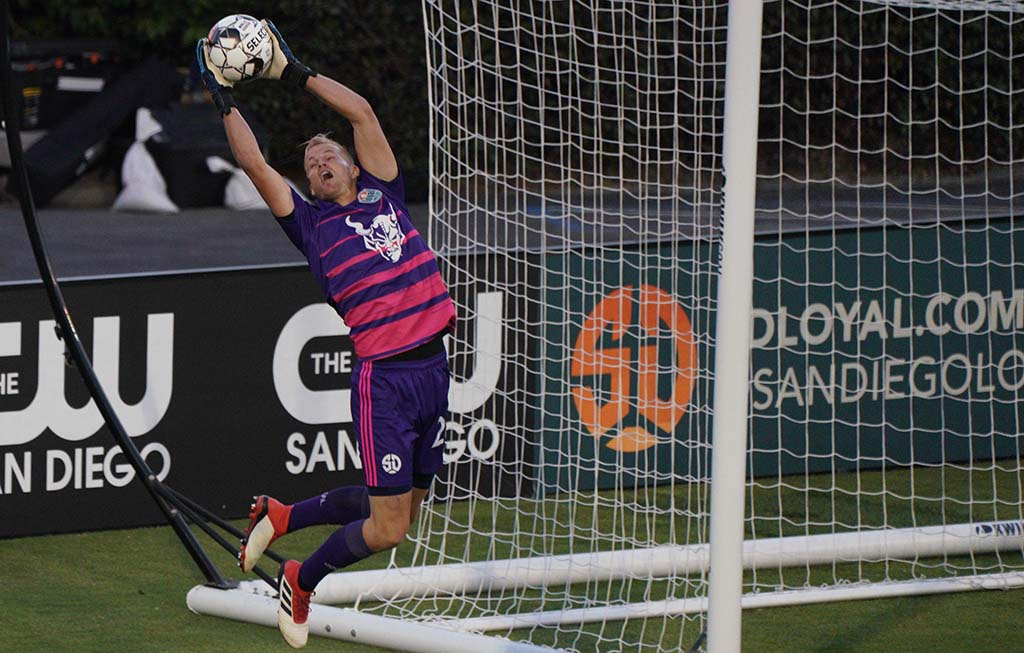 San Diego Loyal goalie Jon Kempin jumps to block a ball during the first half of the match between the Loyal and Las Vegas Lights.
