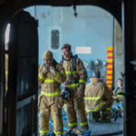Exhausted firefighters aboard USS Bonhomme Richard