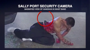Close-up video shows handgun in waistband of man shot by police.