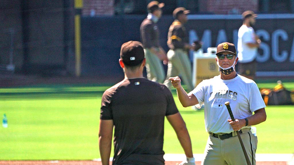 Padres coaches give tips to players at the summer camp that continues through July 23.