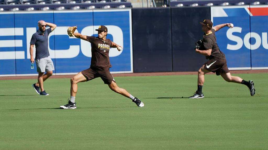 Padre pitches work out in the outfield during early morning practice.