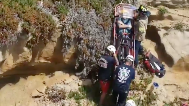 Lifeguards rescue a paraglider