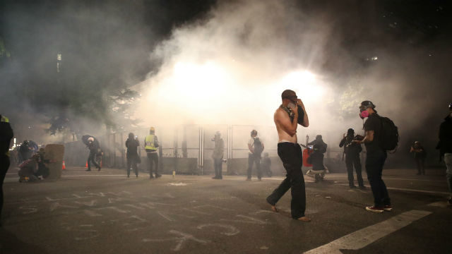 Protesters move away from tear gas in Portland