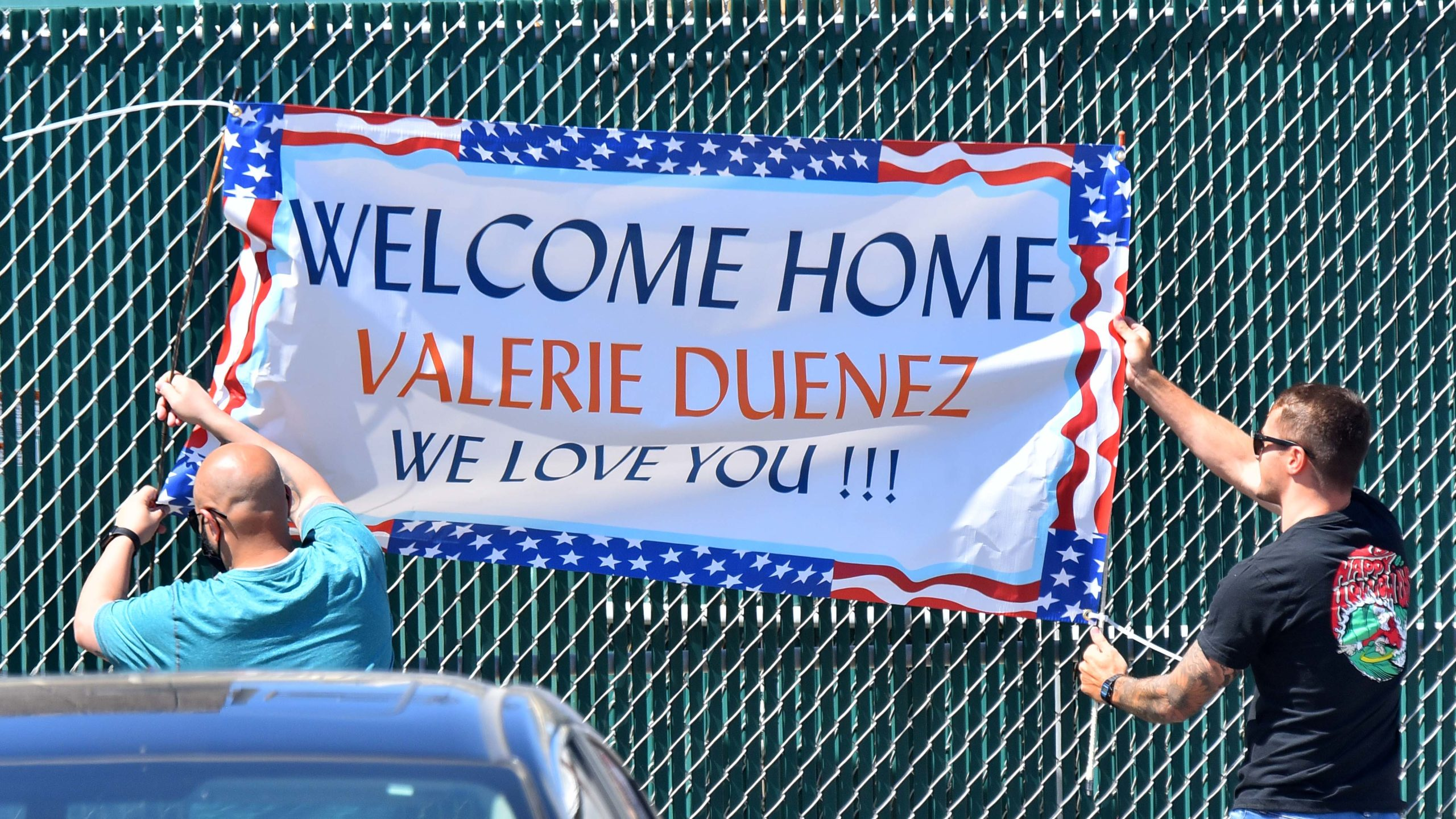 Family members welcome sailor Valerie Duenez, who returned to San Diego with about 5,000 crew members.