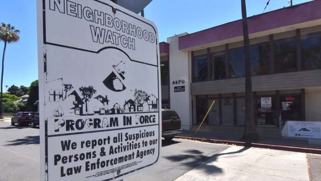 Neighborhood Watch sign across Nebo Drive from Scott McMillan's law office building.
