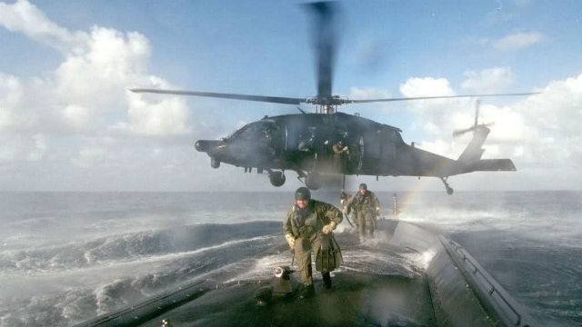 Army special forces deploy aboard a submarine