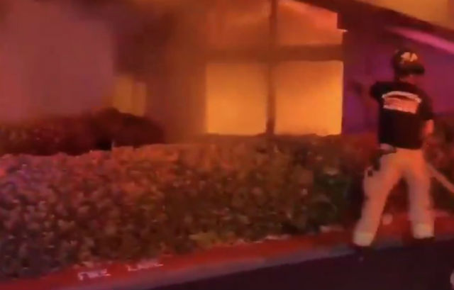 A firefighter battles the blaze in La Jolla
