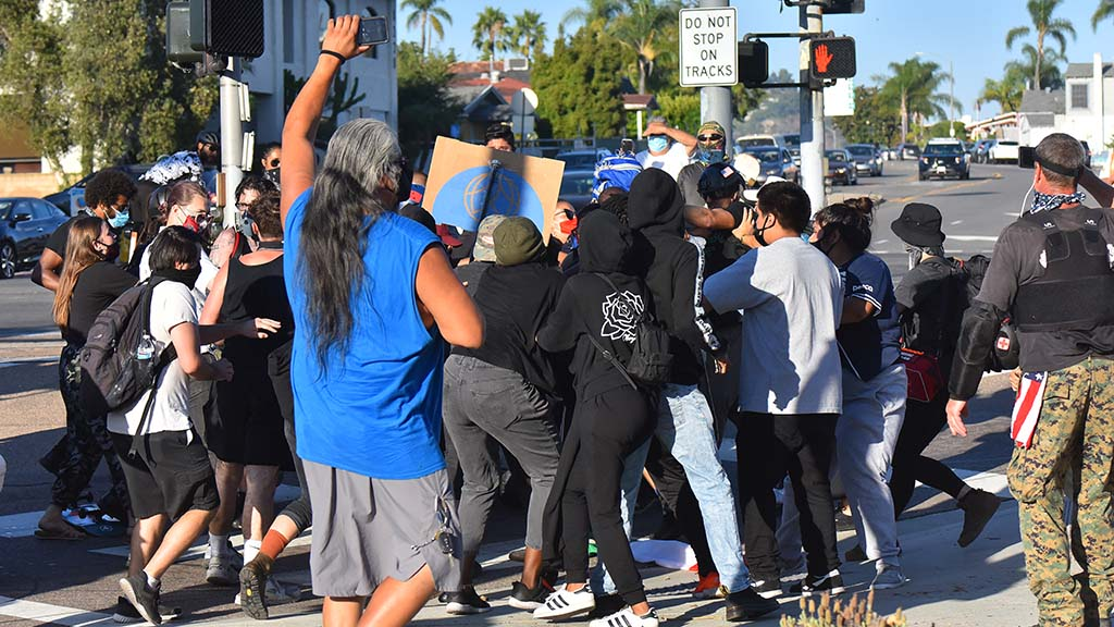 Pushing and shoving took place between Defend East County members and protesters near the intersection of University Avenue and Spring Street.