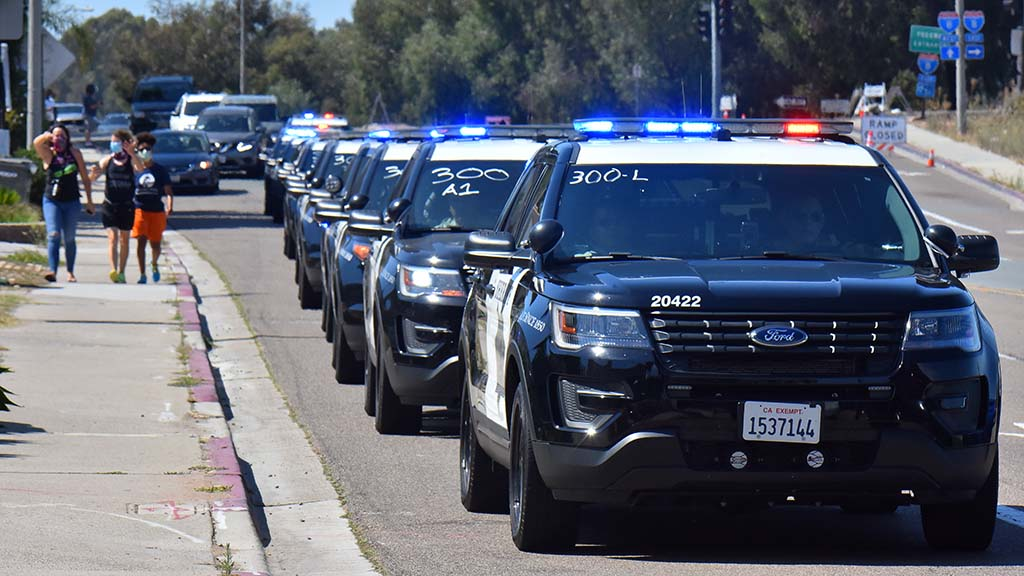 A line of sheriff's cars move into La Mesa to reinforce the police in place for a BLM protest in the afternoon.