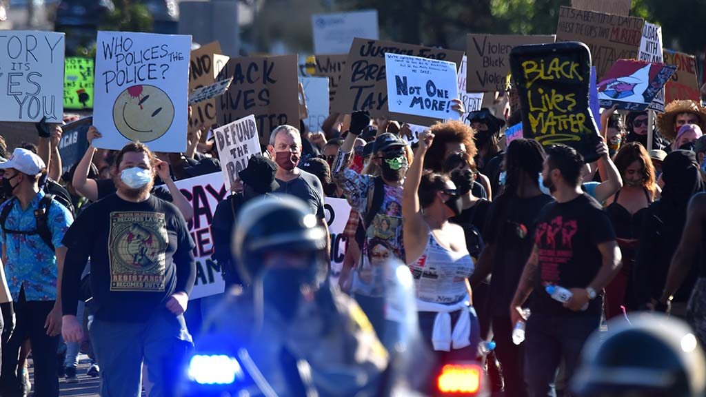 Black Lives Matter protesters march behind a police escort in La Mesa.