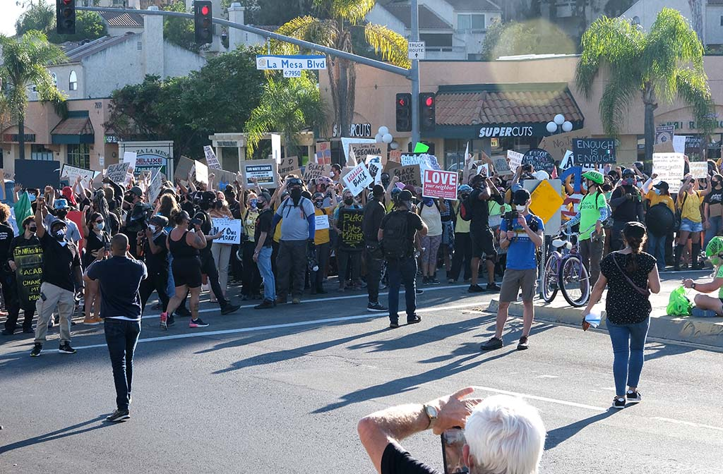Protesters briefly block the intersection of University Avenue and La Mesa Boulevard during a BLM march.