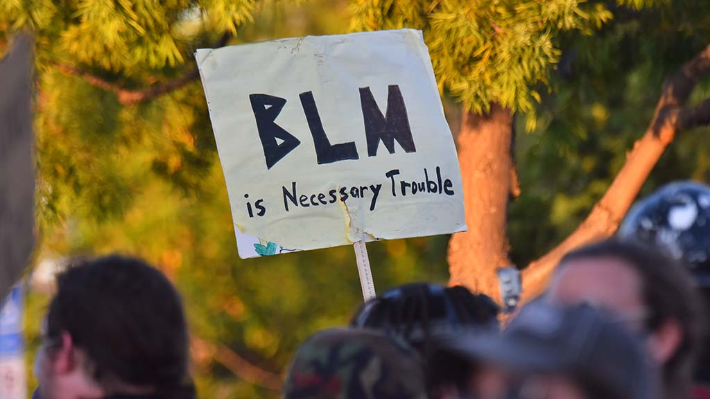 One sign referenced the late Rep. John Lewis' comments about necessary trouble being good.