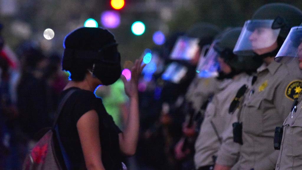 A protestor confronts police as it got dark at the end of the Black Lives Matter protest in La Mesa.