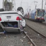 Wrecked SUV on trolley tracks