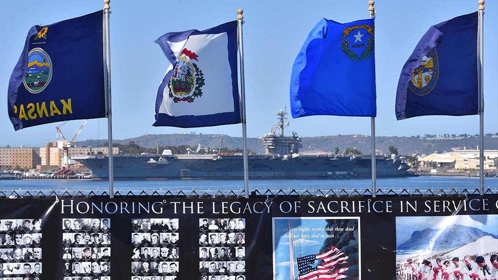 The USS Theodore Roosevelt is docked across the bay from the the the ceremony marking the 75th anniversary of World War II.