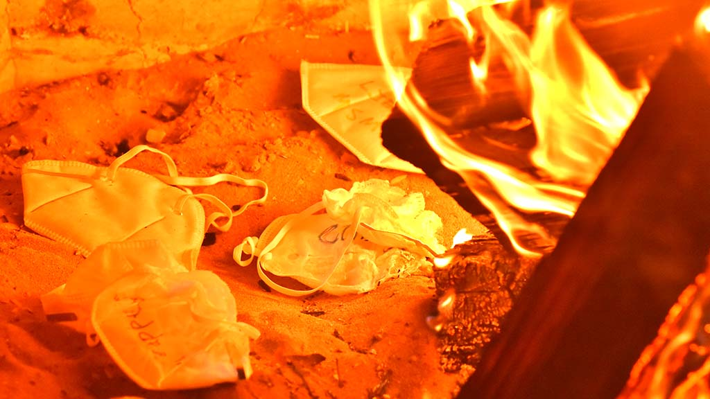 KN 95 masks were thrown into a camp fire at Mission Bay to protest face coverings during the Covid-19 pandemic.