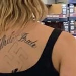 "What appears to be a tattoo of a Nazi swastika under a ""White Pride"" slogan was seen at the Costco in Fenton Marketplace."