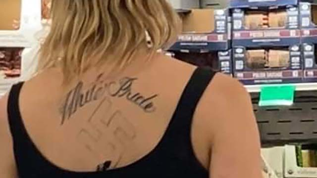 """What appears to be a tattoo of a Nazi swastika under a """"White Pride"""" slogan was seen at the Costco in Fenton Marketplace."""