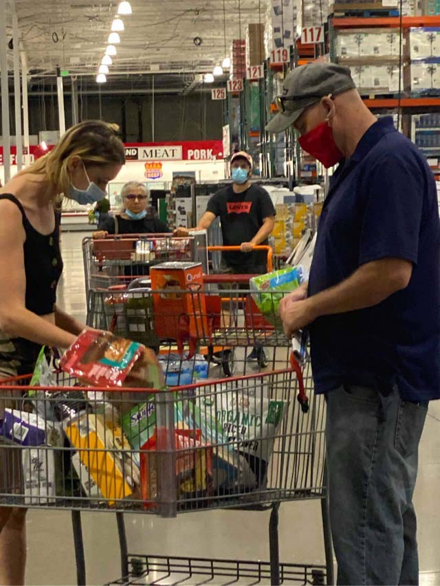 Woman with male partner at Costco in Mission Valley.