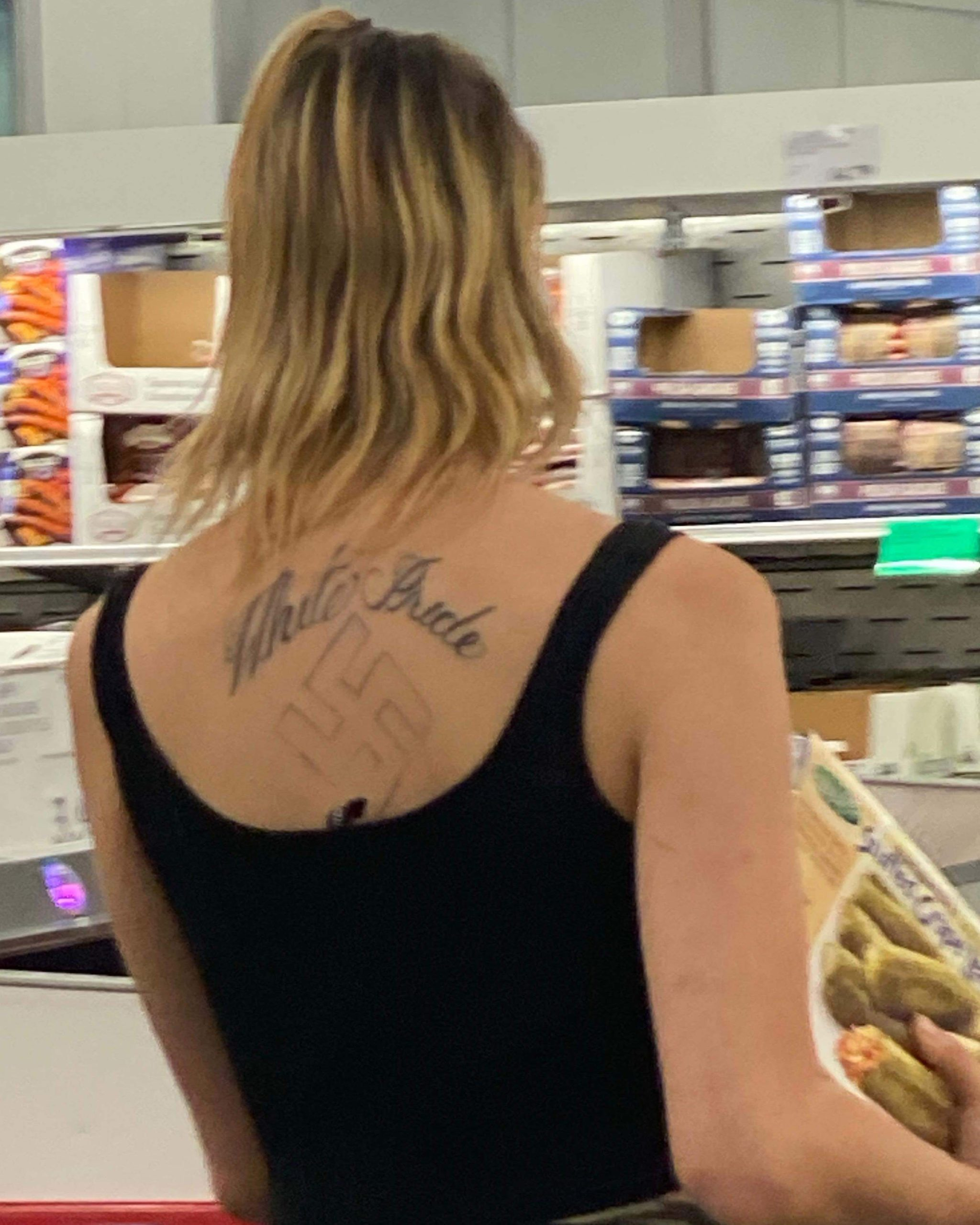 """Woman with """"White Pride"""" tattoo and Nazi symbol shopping at Costco in Mission Valley."""