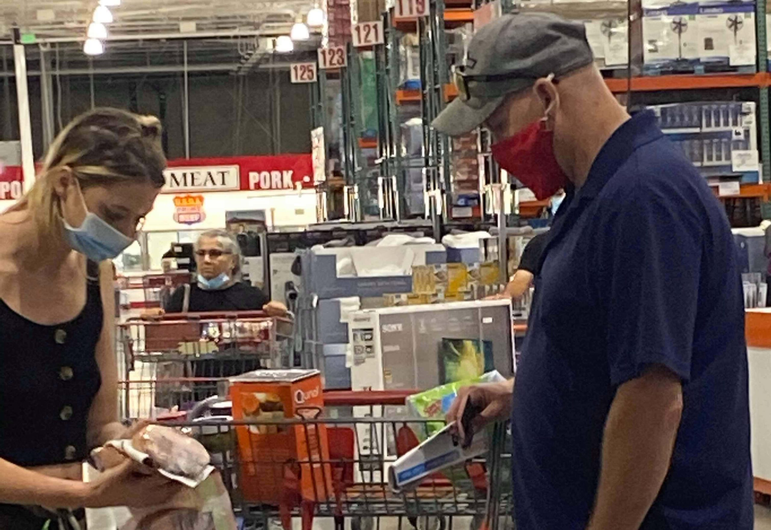 Couple sort groceries at Mission Valley Costco.