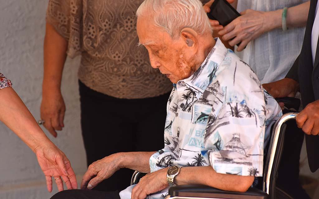 Except for an injury earlier in his life, Khen Ngo, 109, has had good health until this summer. Family members give him helping hands.